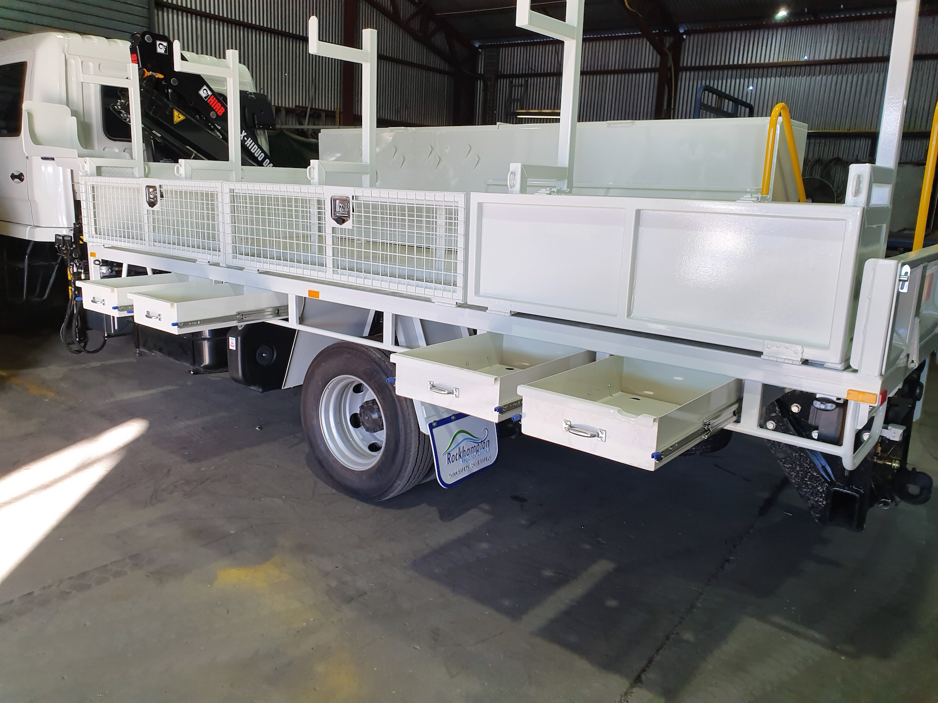 Concreter Truck Storage: Tray body dropside customised to suit toolboxes and storage for Concrete Work HIAB crane fitted