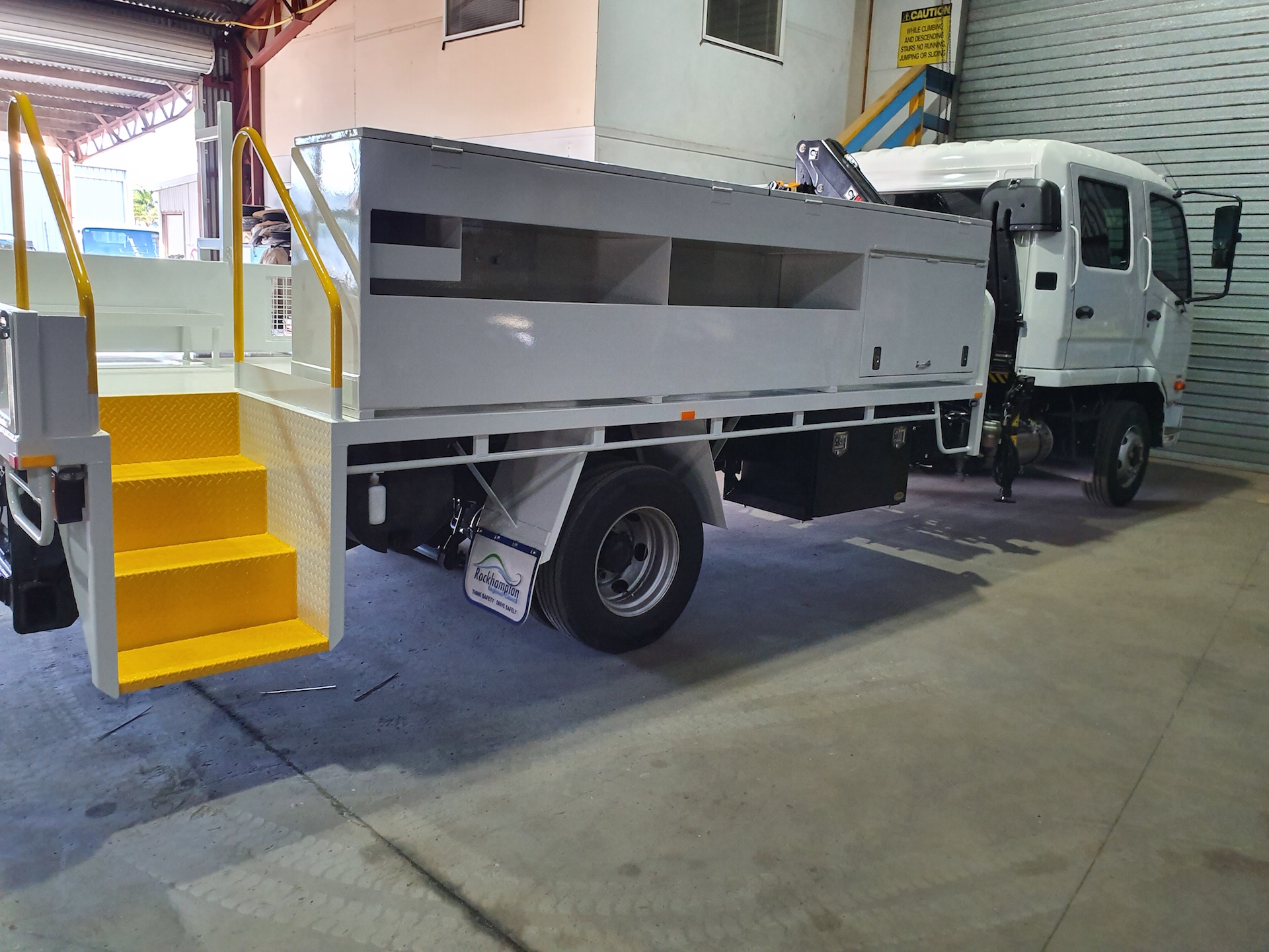Concreters truck: Tray body dropside customised to suit toolboxes and storage for Concrete Work HIAB crane fitted